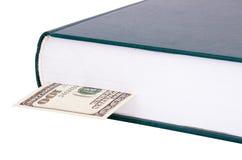 Geschlossenes Buch mit einem Bookmark $ 100 auf dem Recht Stockbilder