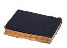 Geschlossenes dunkelblaues Buch lokalisiert auf Weiß Lizenzfreies Stockbild