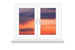 Geschlossenes Fenster mit einer Art auf Sonnenuntergang Stockfoto