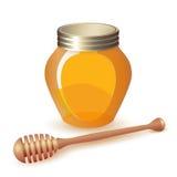 Geschlossenes Honigglas und hölzerner Schöpflöffel Lizenzfreies Stockfoto