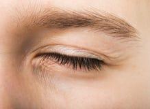 Geschlossenes menschliches Auge Stockbild