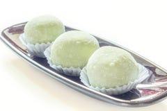 Geschmackkuchen des grünen Tees auf Weiß. Lizenzfreies Stockbild