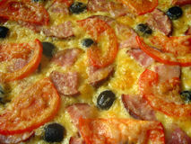 Geschmackvolle appetitanregende Pizza Stockfotografie