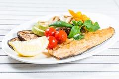 Geschmackvolle gebackene Fische Stockbilder