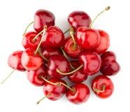Geschmackvolle Kirschen lokalisiert auf dem weißen Hintergrund Stockfoto