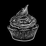 Geschmackvolle kleine Kuchen lokalisiert auf schwarzem Hintergrund Stockfoto