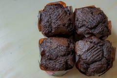 Geschmackvolle Muffins in der einfachen Zusammensetzung Lizenzfreie Stockfotografie
