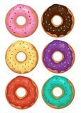 Geschmackvolle Schaumgummiringe eingestellt Farbige Schaumgummiringe mit Sahne und Glasur Lizenzfreie Stockfotos