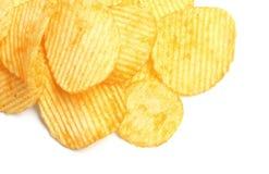 Geschmackvolle zerfurchte Kartoffelchips lizenzfreie stockbilder