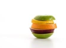 geschnittene Äpfel und orange Frucht Lizenzfreies Stockbild