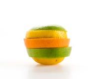 geschnittene Äpfel und orange Frucht Stockfotografie