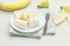 Geschnittene Banane auf Bogen Lizenzfreie Stockfotografie