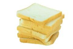 Geschnittene Brote auf weißem Hintergrund Stockfotos