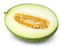 Geschnittene grüne Melone lokalisiert auf weißem Hintergrund Lizenzfreie Stockfotografie