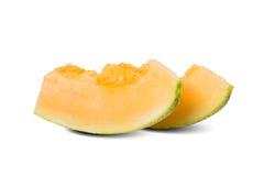 Geschnittene Honigmelone in weißem Hintergrund 2 Stockfotografie