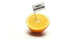 Geschnittene Orange mit Markierungsfahne Lizenzfreie Stockfotografie
