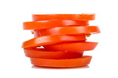 Geschnittene Tomate auf weißem Hintergrund Stockbild