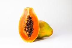geschnittene und ganze frische Papaya Lizenzfreie Stockfotografie