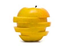 Geschnittener gelber Apfel Stockfoto