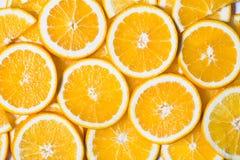 Geschnittener orange Hintergrund Nahrung und Getränk Stockfotos