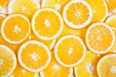Geschnittener orange Hintergrund Nahrung und Getränk Lizenzfreie Stockfotos