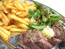 Geschnittenes Steak auf einem Tellersegment Stockfoto