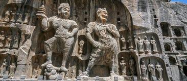 Geschnitzte Buddha-Bilder bei Longmen höhlt, Dragon Gate Grottoes aus Lizenzfreie Stockbilder