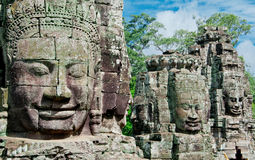Geschnitzte Gesichter von Angkor Lizenzfreie Stockfotografie