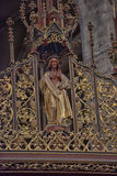 geschnitzte hölzerne Skulptur eines Heiligen Stockbilder