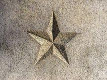 Geschnitzter Stern 5-Pointed im Granit stockfoto