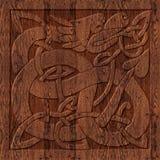 Geschnitztes hölzernes keltisches Symbol Stockfotografie