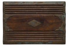 Geschnitztes hölzernes Panel mit beunruhigtem beflecktem Metall Stockfotos