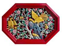 Geschnitztes Schwan-und Blumen-Bild Stockbild