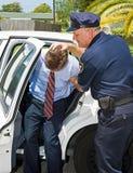 Geschoben im Polizeiwagen Lizenzfreies Stockbild