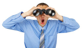 Geschokte bedrijfsmens met blauwe band met verrekijkers Royalty-vrije Stock Fotografie