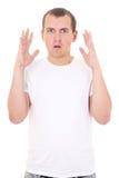 Geschokte jonge die mens op wit wordt geïsoleerd Stock Foto