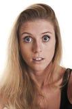 Geschokte jonge vrouw Stock Afbeelding
