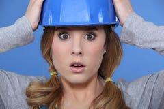 Geschokte vrouwelijke bouwer Royalty-vrije Stock Foto