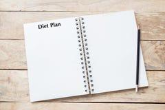 Geschreven het programma van het gewichtsverlies over boek met zwarte lijst, conceptuele planning royalty-vrije stock afbeelding