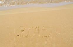 2015 geschreven in het zand Stock Afbeelding