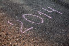 2014 geschreven op asfalt Stock Foto's
