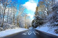 2017 geschreven op de winterweg Stock Foto