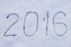 2016 geschreven op sneeuw Stock Foto's