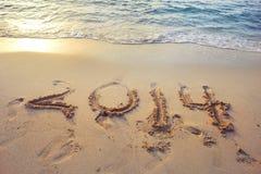 2014 geschrieben auf den Sand Lizenzfreie Stockfotos