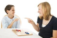 Geschwister-Spiel-Spiele Stockfoto