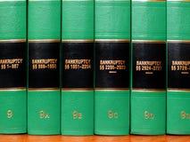 Gesetzbücher auf Bankrott Stockfotografie