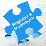 Gesetzeskonzept: Registrieren Sie ein eingetragenes Warenzeichen auf Puzzlespielhintergrund stock abbildung