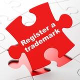 Gesetzeskonzept: Registrieren Sie ein eingetragenes Warenzeichen auf Puzzlespielhintergrund vektor abbildung