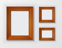 Gesetzte klassische Holzrahmen auf weißem Hintergrund Stockbilder