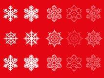 Gesetzte Schneeflocken des Vektors lokalisiert auf rotem Hintergrund Stockbild